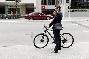 Businessman on bicycle © Shutterstock